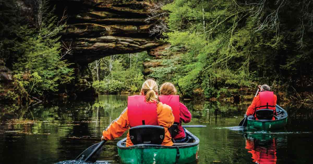 Canoeing Under a Large Rock Arch at Pickett CCC Memorial State Park