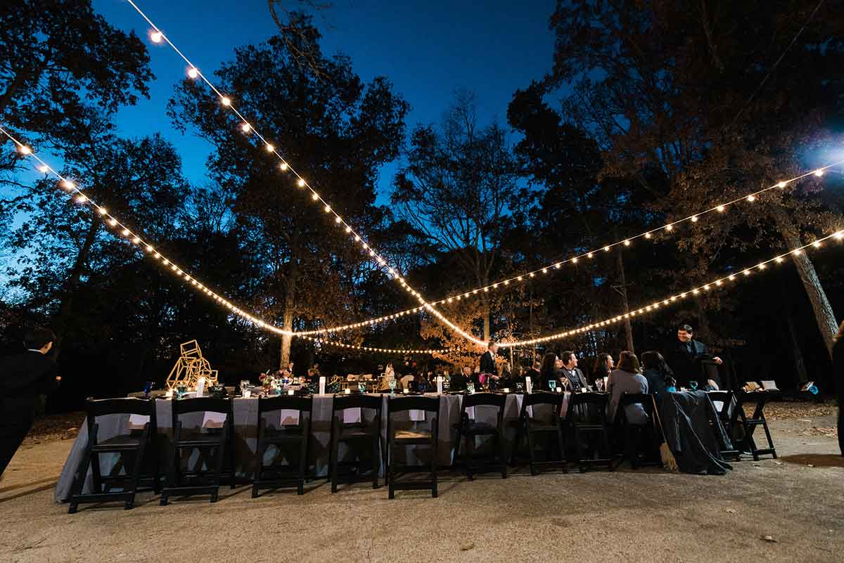 String lights and table set up outdoors at Cedars of Lebanon State Park